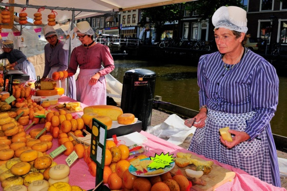 Woman selling Cheese at Alkmaar Cheese Market, North Holland,