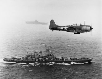 SBD_VB-16_over_USS_Washington_1943