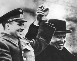 Gagarin, with the first man of the Soviet Union, party secretary Nikita Khrushchev, greets the people from a decorative tribune placed on top of the Lenin Mausoleum.