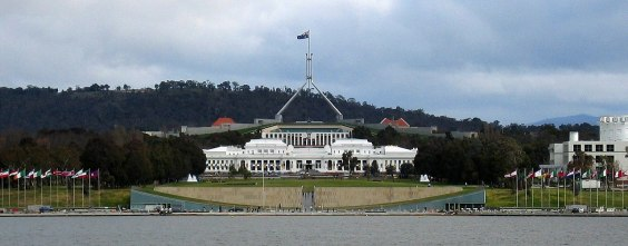 The old and behind it is the new parliament in Canberra