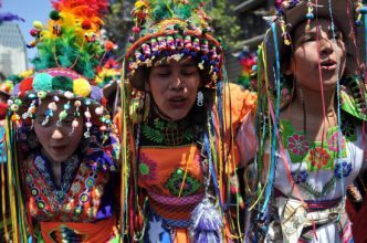 Mapuche girls march at a political rally