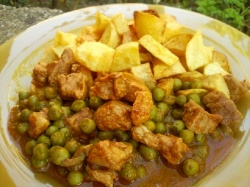 Pork stew with green peas
